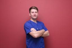 4. lekarz stomatolog, chirurg  Michał Buliński